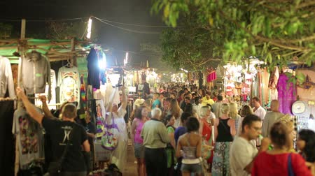 holiday makers : GOA, INDIA - MARCH 2013: Tourists in traditional street market