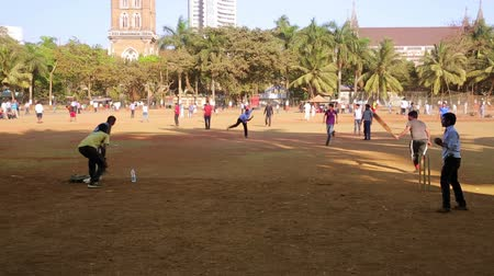 kriket : MUMBAI, INDIA - MARCH 2013: Group of people playing cricket in local park at city center
