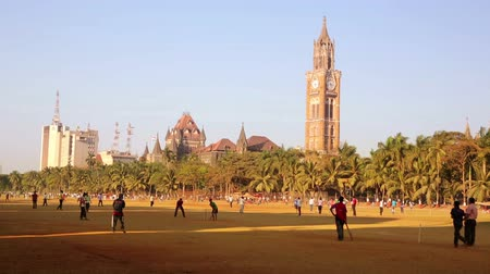 kriket : MUMBAI, INDIA - MARCH 2013: Group of people playing cricket in local park