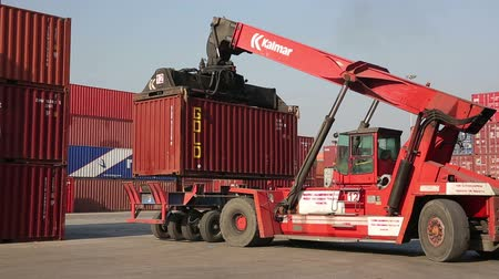 truck crane : IZMIR, TURKEY - JANUARY 2013: Moving freight containers in the docks of Izmir Harbour