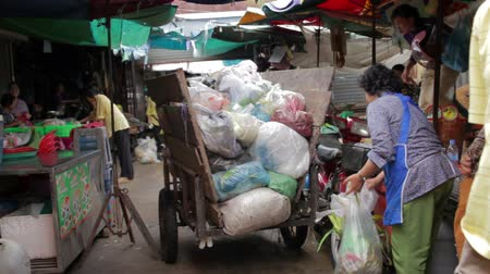 southeast : PHNOM PENH - JUNE 2012: local asian market dumping Stock Footage