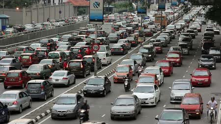 busy line : KUALA LUMPUR - MARCH 2012: traffic jam in city center