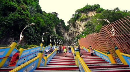 asian and indian ethnicities : KUALA LUMPUR - MARCH 2012: people climbing batu caves steps