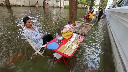 floods : people are continue Selling in flood in Bangkok Thailand. Life continues