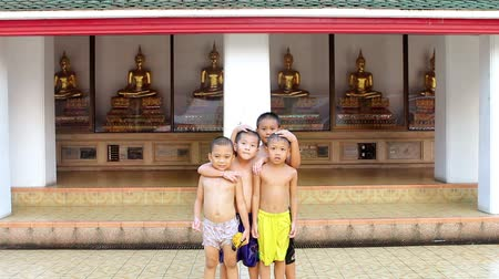boudha : Children and Golden Buddha Statues Stock Footage