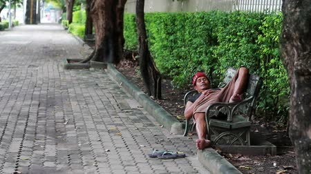 abandoned old : homeless man sleep on bench