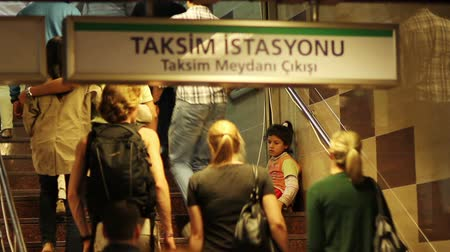 fome : poor child begging at the entrance of istanbul taksim metro and people passing without helping