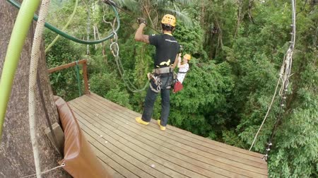 Пхукет : PHUKET, THAILAND - JUNE 2014: Zipline flying Стоковые видеозаписи