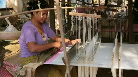 maquinaria : SILK ISLAND, CAMBODIA - MARCH 2014: cambodian woman silk textile manufacturing at her house.
