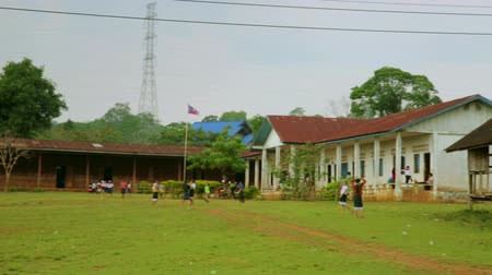 unicef : PAKSE, LAOS - APRIL 2014: Students at School garden Stock Footage