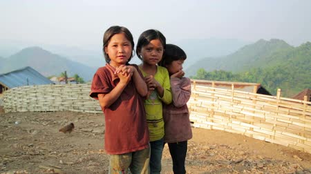 hill tribe : PONGSALI, LAOS - APRIL 2014: native Akha kids in their hill village