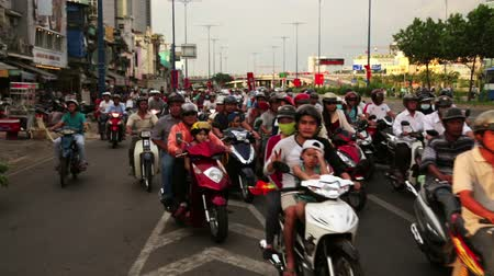 hora : SAIGON, VIETNAM - MAY 2014: crazy motorbike traffics
