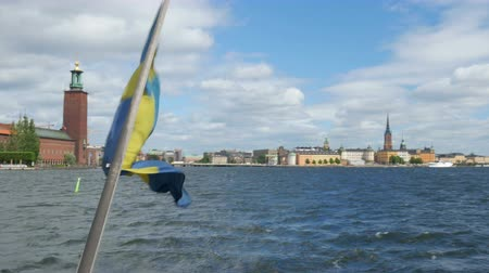 ship with swedish flag leaving from old city, stockholm, sweden