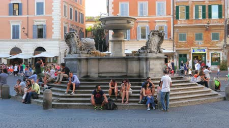 ROME - ITALY, AUGUST 2015: people enjoy around italian fountains