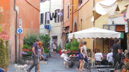 outside view : ROME - ITALY, AUGUST 2015: people travel enjoy on streets