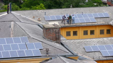 panel buildings : worker installing solar panel roof top apartment