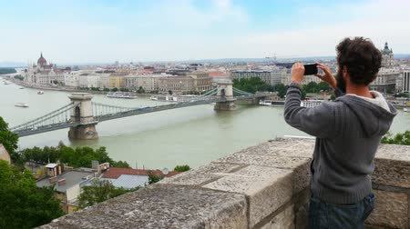 single man enjoy with budapest river view, hungary, 4k Vídeos