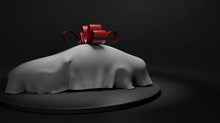 3D animation of a luxury car wrapped under a sheet with a big red bow