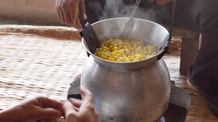 сделанный : Boiling yellow silkworm cocoons by boiler to make silk thread.