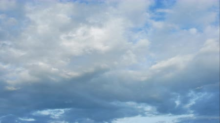 puffy cloud : Time Lapse of White fluffy clouds in the blue sky background Stock Footage