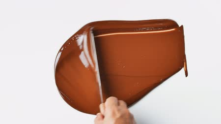 temper : Tempering chocolate temperature for using a marble working surface Stock Footage