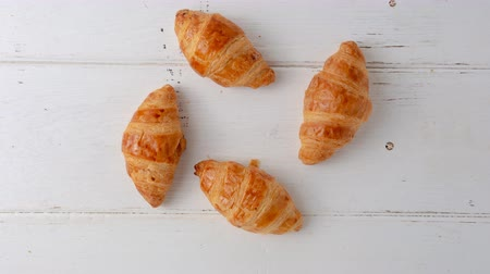 fuvalom : Motion stop of Freshly baked croissants on white wooden background