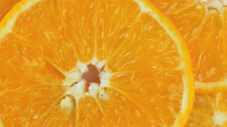 апельсины : Fresh Sliced ​​oranges background rotate.Close up Стоковые видеозаписи