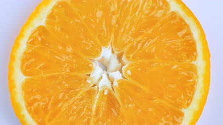 pomarańcza : Fresh Sliced ​​oranges background rotate.Close up Wideo