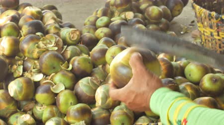 banany : Man Using Knife To Cut Open Toddy Palm Fruit.