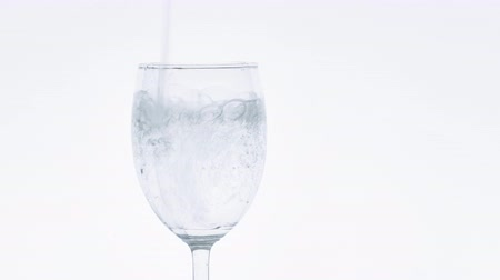 champagne flute : Pouring soda water into a clear glass. Stock Footage