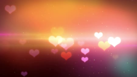 hapiness : beautiful heart shaped bokeh high definition video with sparkles and light effects