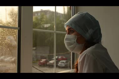 latex gloves : woman doctor in medical mask window.