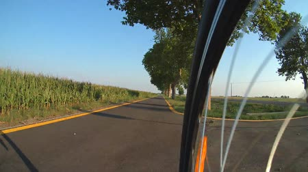 Cycling outside of the city on bike road. Time-lapse