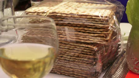 pascha : Matzah, lettuce leaves, wine are traditional elements of the celebration of the Jewish Easter holiday - Petsakh. Close up, Full HD 1080p
