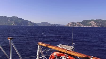 лодки : Gulf of Gekova in Aegean Sea, view from cruise boat,  Turkey Стоковые видеозаписи