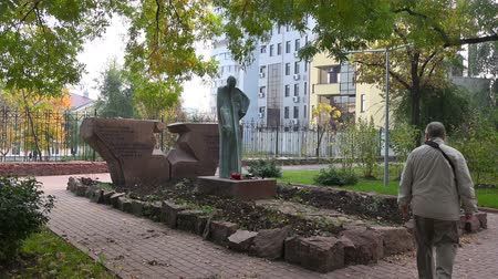 six worlds : CHISINAU, MOLDOVA - 18.10.2017:  A man near the monument to the victims of the Chisinau ghetto
