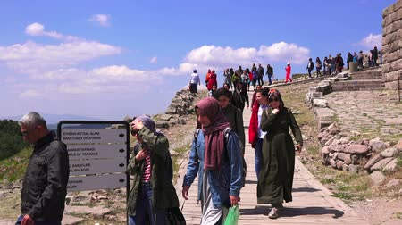 rock wall : Bergama, Turkey - April 21, 2018: Tourists visit the ruins of the ancient city of Pergamon, the famous museum