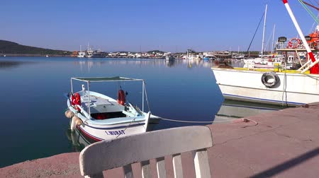 motorbot : Ayvalik, Turkey - April 22, 2018: View of the sea dock of Junda ( Alibey) Island on a clear sunny day