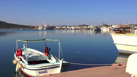 Эгейский : Ayvalik, Turkey - April 22, 2018: View of the sea dock of Junda ( Alibey) Island on a clear sunny day