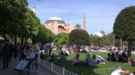 ottoman : City landscape in the Sultanahmet area in front of the Hagia Sophia cathedral.  Sunny day, people are resting in the park, 30.04.2017, Turkey, Istanbul Stock Footage