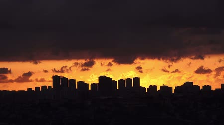urban scenics : Timelapse sunset on the cloudy sky over city,  Turkey, Istanbul