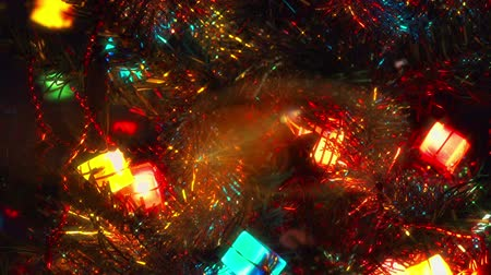 golden ribbon : Christmas tree lighted garland in closeup Stock Footage