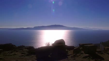 medeniyet : Assos, ancient ruins on the sea background at sunset,  Behramkale, Turkey Stok Video