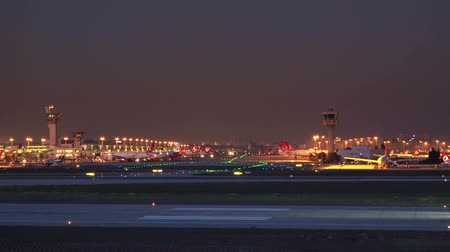 ascend : ISTANBUL, TURKEY - OCTOBER 11, 2018: Ataturk International Airport at sunset. Turkish Airlines plane on the runway