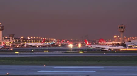 ISTANBUL, TURKEY - OCTOBER 11, 2018: Ataturk International Airport in the evening.Turkish Airlines plane on the runway Stock mozgókép