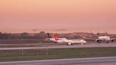 ISTANBUL, TURKEY - OCTOBER 11, 2018: Ataturk International Airport at sunset. Turkish Airlines plane on the runway