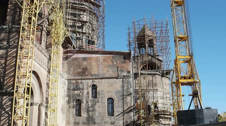 restaurálás : Gyumri, Armenia -Nov 3: workers care about Surp Amenaprkich chapel Stock mozgókép