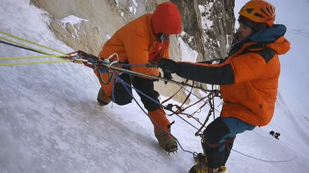 wspinaczka : Alpinist pull up weight at a slope of mountain to top. Wideo