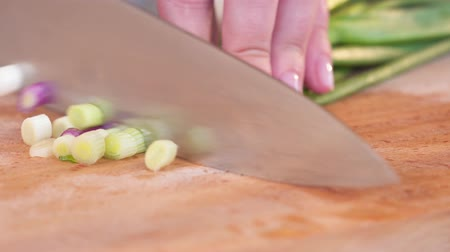 nutriente : hands of the girl. onion cutting Stock Footage