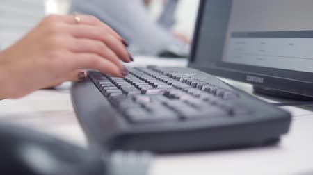 business, people, technology and programming concept - close up of hands typing on computer keyboard in office